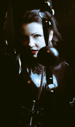 Mistress holding a ball gag