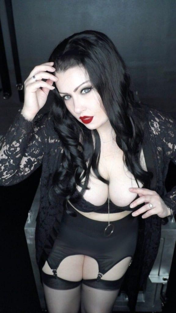 Fair skinned dominatrix in lingerie