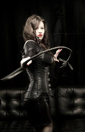 Dominatrix using a whip