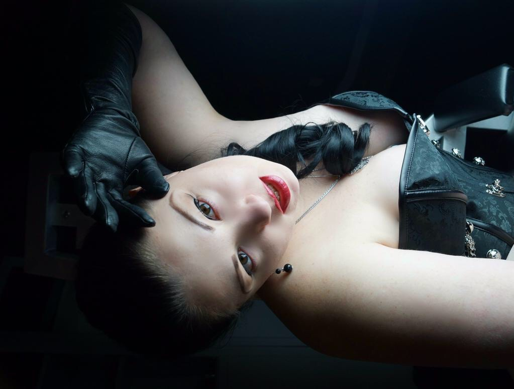victoria rage wearing gloves and corset
