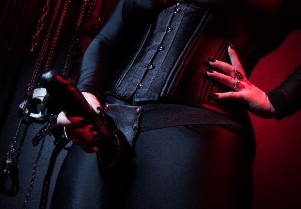 dominatrix wearing strap on
